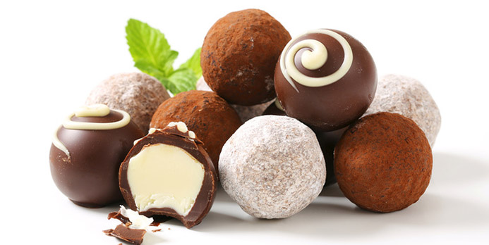 Beautiful truffles are the easiest candy to make. Just take a container of your favorite frosting and scoop a bite size amount; roll to make even then roll in powdered sugar, cocoa or drizzle more chocolate over. Your guests will love them!